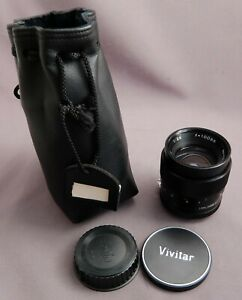 Vintage Vivitar Auto 100mm f2.8 lens in Nikon F mount + caps & sack.