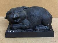 Bronze Sculpture of a Laying Pig