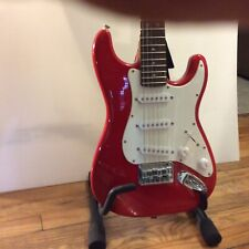 Squier Mini Electric Guitar Strat by Fender, Red