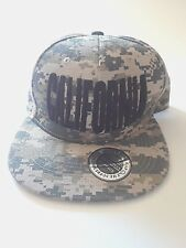The Supreme Cap California Spellout Digital Camouflage Snapback Hat.