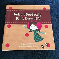 LYNDAL OUTRAM SIGNED BOOK, DELIA'S PERFECTLY PINK EARMUFFS. 9780994282903