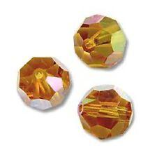 1 Perle Ronde cristal Swarovski 10mm 5800 TOPAZ AB