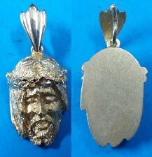 Cabeza de Nazareno en Oro 18 quilates. Peso 7,50 gr. Tamaño 25 mm.