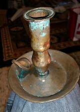 vintage hammered copper candle holder finger holding candlestick base