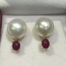 10.5 MM Freshwater Pearl. With A Cabachon Ruby In 14k Yellow gold.