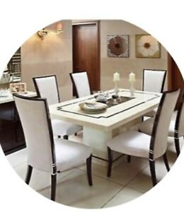 Marble Dining Table With Four Cream And Two Brown Chairs