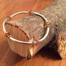 Sterling Silver Bracelet  w/ Topaz Color Swarovski Crystals - Stretch On