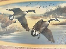 A Pair of Canada Geese, flying South on a Fall Afternoon, on a Wood Paddle