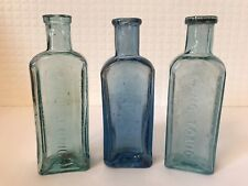 More details for lot of three vintage blue glass embossed owbridge's lung tonic hull bottles