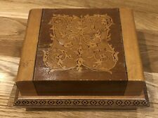 A VINTAGE WOODEN INLAID CIGARETTE POP-UP MUSICAL BOX