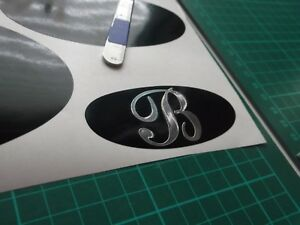BESSACARR OVAL  5 X STICKERS  CHROME ON BACKGROUND COLOUR
