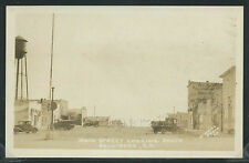 SD Belvidere RPPC 1920's DIRT STREET SCENE Cars STORES Truck by O'Neil Photo Co.