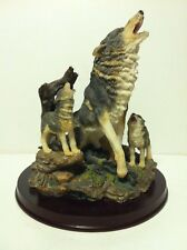 Howling Wolf and Pups on Wood Base