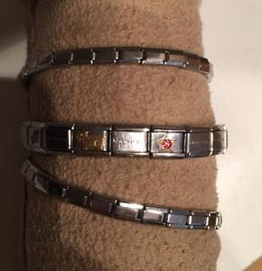 3 Armbänder Nomination mit mehreren goldfarbenen Elementen M W J Buchstaben