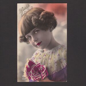 Vintage color postcard, Young girl with flowers, Posted in 1932 Netherlands