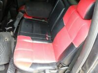 2007 F-250 Lariat Outlaw rear passengers seat black and red leather
