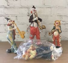 Lot Of 4 Musical Clown Figurines Saxophone