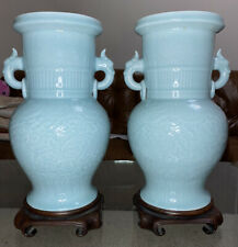A large pair of 19th century Chinese celadon glaze vases and rose wood stands