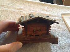 Wood wind up house music box