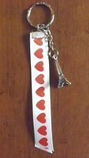 porte clés argenté tour eiffel + ruban
