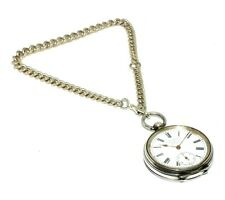 Solid silver antique pocket watch with original key on a graduated albert chain