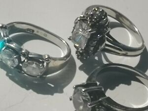 A Trio Of Hallmarked Silver Ladies Dress Rings With Cubic Zirconia Decoration..