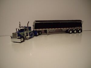 DCP FIRST GEAR 1/64 PETERBILT 389 WITH SLEEPER AND LODE KING TRI-AXLE GRAIN