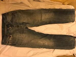 Mens dark wash Levi 501 Red Tab boot cut classic 5 button jeans