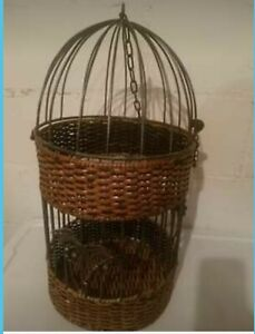 Wicker Hanging Bird Cage With Palm Trees On It