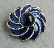 1.5 inches diameter, good condition. Avon blue enamel spiral scarf brooch,