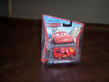 DISNEY - PIXAR - CARS 2 - LIGHTNING MC QUEEN - PISTN CUP - OKAY CARD - NEW