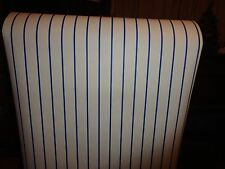 Narrow navy blue stripes on off white wallpaper.