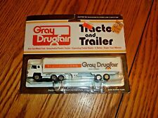 1970's NOS GRAY DRUGFAIR TRACTOR AND TRAILER SEALED ON CARD