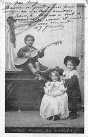 """CPA - cartes fantaisies - 2 petites filles et 1 petit garçon """"guitariste """""""