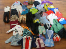 Lot #1  Ken Doll Clothes & Others (50 Pieces)