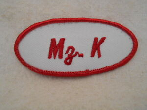 MZ. K  USED EMBROIDERED VINTAGE SEW ON NAME PATCH TAGS OVAL RED ON WHITE