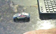 Matchbox 1990 Blue & Yellow Strips Nissan 300ZX 1:64 Scale Die Cast Car