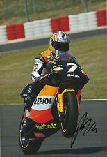 Randy de Puniet Hand Signed Repsol Aprilia 250cc 2005 12x8 Photo.