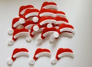 x20 Felt santa hat embellishments.Santa hat die cuts