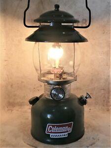 Coleman 201 kerosene lantern, made USA 12/81, rough, new generator, burns good.