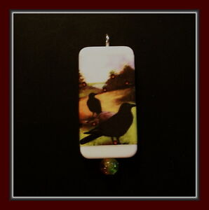 TWO OLD CROWS IN A FALL FIELD DOMINO PENDANT