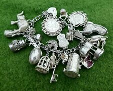 FABULOUS 1960s SILVER CHARM BRACELET WITH 26 ATTRACTIVE SILVER CHARMS - 3.07 ozt