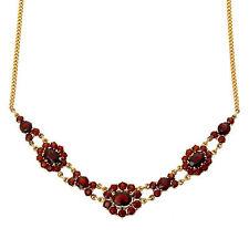 Halsketten und Anhänger aus Gelbgold mit Granat-Edelsteinen