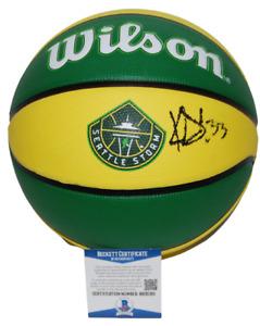 KATIE LOU SAMUELSON signed (SEATTLE STORM) Logo basketball ball BECKETT BB35301