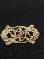 Vintage Gold Tone Antique Style Red Rhinestone Open Scroll Crest Pin Brooch