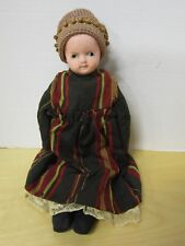 "13"" antique composite doll - glass eyes - hard stuffed oilcloth body with label"