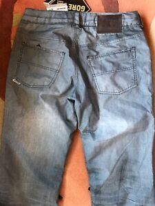 Burton blue denim jeans snowboard ski pants. New. Men's medium. Gore-tex
