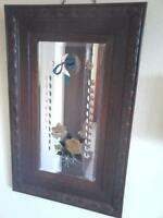 Vintage heavy plate glass bevelled mirror in Oak frame with flowers horse shoe