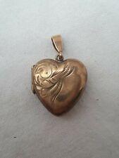 Small 9ct gold heart locket pendant.