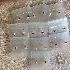 JOB LOT-10 pairs of 8 different colours 0.5cm stone diamonte stud earrings.